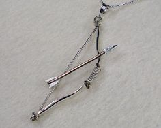 (Archery Bow and Arrow Necklace Made with by SilverHorizonDesigns, $45.00)