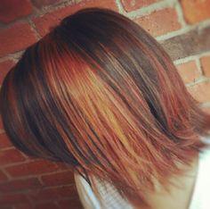 Auburn Hair with peek thru panels compliment this razor cut. #kouklasalon #auburnhair