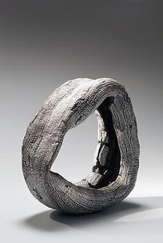 """Futamura Yoshimi. Medium-sized sculpture with bands of inlaid pre-fired white porcelain, titled """"Meditation Circle."""" 2012 Stoneware and porcelain"""