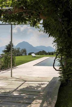 Villa Comano by Attilio Panzeri & Partners boasts a breathtaking view over the Lugano Lake - CAANdesign Lugano, Villas, Beautiful Pools, Garden Pool, Switzerland, Terrace, Swimming Pools, Building A House, Backyard