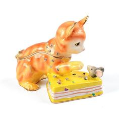 """#Cat And Mouse With Cheese Trinket Box Item No. KB00409A01 $30.79 This cute trinket box features a playful kitty, with a mouse in some cheese! The cat opens up to reveal a small area to keep jewelry or other tiny things. This piece is decorated with small crystals and has gold plating."""" Kitten, Cat, Keep Jewelry, Keepsake Boxes, Gold Plating, Trinket Boxes, Dinosaur Stuffed Animal, Cheese, Crystals"""