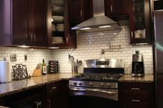 Cherry cabinets, counters, white tile with dark grout