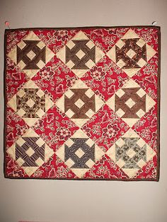 INSPIRED BY ANTIQUE QUILTS:  I love using one main focus print for the plain blocks and making the pieced blocks scrappy.