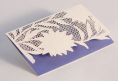 Laser Cut Dahlia Note: Presented with the most enticing texture, these notes feature an intricate laser cut floral design atop cobalt. Sure to please the correspondent with a style equal parts confident and romantic.