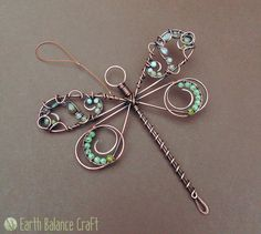 The willow dragonfly suncatcher is adorned with watery gemstones and glass beads.