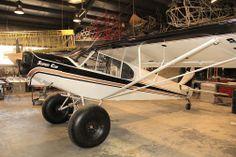 Alaskafoto slideshow of the Alaska Airmen Association raffle plane a PA18 Super Cub on 35 inch Alaska Bushwheels!