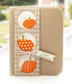 peek-a-boo pumpkins...pumpkins peek out of circles cut in patterned column...cute a clean design...