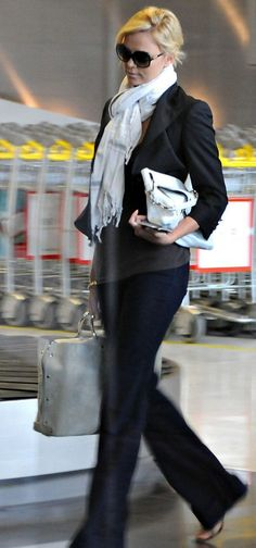 Can you wear bootcut jeans with flats?  Why, yes you can. Charlize Theron in bootcut jeans and flats at the airport.
