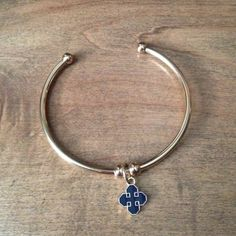 Gold Bangle Bracelet with Blue Charm NEW Brand new (no tags were provided, purchased at boutique in Atlanta). Boutique Jewelry Bracelets