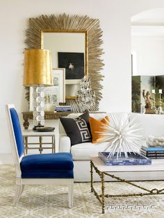 Living room with blue, orange, and gold accents. Another Design by Melanie Turner