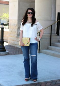 Affordable glam boho look for spring. Off the shoulder top ($10), flare jeans ($15), and pom-pom clutch ($22).