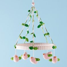 Pink & green bird & vine mobile - so sweet. (Pic only, no tutorial.) I want to make vines like this by tying green embroidery thread over figure 8 cloth leaf cut-outs.