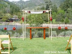 Ceremony Chuppah @ Calistoga Ranch Wedding  Red roses and spray roses, mini callas and James Storie orchids. Flowers and photo by The Wild Orchid floral design in Sebastopol.