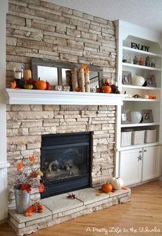 stacked stone fireplace, white mantel.