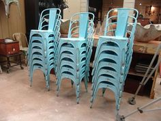 stacks and stacks of vintage tolix chairs - perfect for dinner parties in the barn