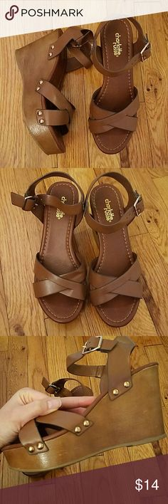 Charlotte Russe wedge sandals Brown wedge sandals from charlotte Russe. Used once. Great condition. Plastic wedge material. Charlotte Russe Shoes Wedges