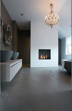 Minimal bathroom, dark Matt bath and sinks, concrete black floor. This is so gorgeous and serene. (not the fireplace tho, eaven if its gorgeous) Minimal Bathroom, Modern Bathroom, Cement Bathroom, Bathroom Bath, Bath Tub, Bathroom Cabinets, Bath Room, Design Moderne, Deco Design