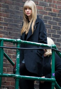 Winter chic: The singer was wrapped up warm but looked lovely in her corduroy coat and kinky leather boots