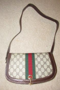 Gucci Horsebit Vintage Line Purses Brown Large G Logo Print Canvas and Brown Leather with A Red and Green Sherry Stripe Shoulder Bag Vintage Purses, Vintage Gucci, Vintage Handbags, Shoulder Purse, Leather Shoulder Bag, Gucci Horsebit, Gucci Purses, Brown Purses, Canvas Leather