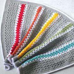 V-Stitch Rainbow Crochet Blanket Pattern | The fun rainbow stripes on this easy crochet blanket are perfect for any newborn!