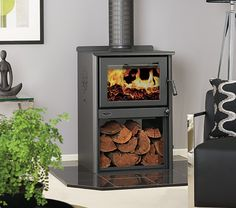 Coonara have been proudly manufacturing in Australia for over 34 years and the Settler Ranch Freestanding Wood Heater exemplifies the brand's ability to combine both tradition and innovation. Freestanding Fireplace, Beach Shack, Kitchen Fixtures, Wood Storage, Home Renovation, Man Cave, Ranch, Living Spaces, New Homes