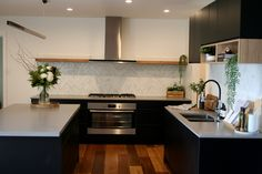 Matte black and timber accent kitchen. Sleek new contemporary kitchen with long timber shelf and feature wall shelf White Wood Kitchens, Timber Kitchen, White Kitchen Decor, Home Decor Kitchen, New Kitchen, Kitchen Flooring, Kitchen Ideas, Kitchen Cabinets, Simple Kitchen Design