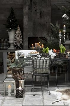 Driftwood tree, shades of gray, candles in the fireplace...lovely ideas here.