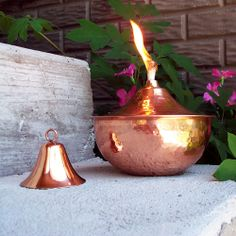 """The Medium Hammered Copper Tabletop Torch is a simple way to spice up a table or ledge. At only 6"""" in diameter, you can add some flavor, without taking up valuable space. The fiberglass wick is included so your flame will last through whatever nature has in store. The torch holds 16 oz of fuel for hours of candlelit enjoyment."""