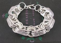 Rings bracelet made with soda cans. - Recycled Soda Pop Tops Upcycled Statement Bracelet by jillmccp, Pop Top Crafts, Can Tab Crafts, Soda Tab Crafts, Tape Crafts, Wire Jewelry, Jewelry Crafts, Handmade Jewelry, Jewellery, Recycled Jewelry