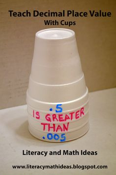 Use cups to teach decimals.  Click the image to see helpful teaching ideas