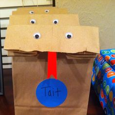 Brown lunch sacks I made into snake goody bags for Tait's reptile birthday party.