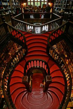 Neo-gothic bookstore in Livraria Lello, Porto, Portugal opened it's doors in 1906 and is home to the most magical, enchanted staircase