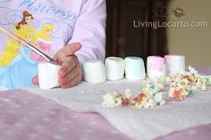 Popcorn & Marshmallow painting. Hmmmm... Now this is a better idea. I think I should do this for Thanksgiving for when the little ones come to visit. How fun. :-) At least it will give them something to do instead of running around under our feet in the kitchen. Tehe Tehe...