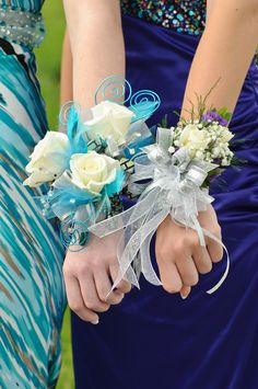 Wrist corsage - love the colours in the one on the left.