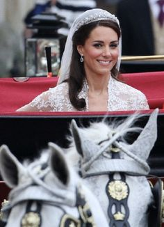 Catherine, Duchess of Cambridge leave Westminster Abbey in a carriage after their wedding ceremony in London, Britain, 29 April 2011