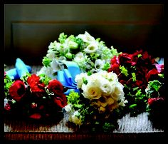 bride and maids bouquets for a turquoise, red and white wedding...anenomies, white lilac, fresia, dahlia...