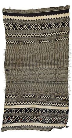 Africa   Blanket from Morocco; in brown and white with geometric patterns and small red accents in the border   Wool and cotton   Early 20th ceentury