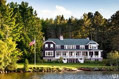 The three-level residence is a modern adaptation of an Adirondacks great camp, the Gilded Age family compounds built around the region's lakes | archdigest.com