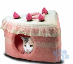 We have covered plenty of fun cat beds in the past. TheStrawberry Cake Cat Bed happens to be a self-heating cat bed with a cute design. It measures 10″ high x 18″ wide at the back and 16″ deep from tip to back. The opening is large enough for a cat or small dogs. Cleaning
