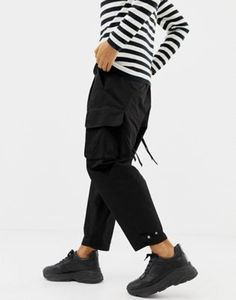 79eb60e85b Image 1 of ASOS DESIGN cargo trousers with strapping in black Asos Men,  Chinos,