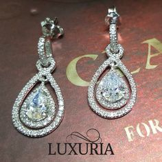 Elegant pear shaped bridal dress or evening gown diamond simulant earrings.  Luxuria Jewellery, 925 Sterling Silver Jewelry NZ
