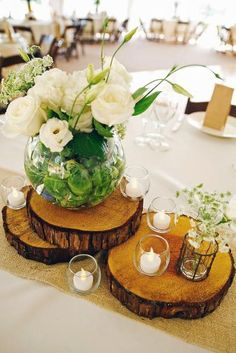 """From Buttons to Garden Paths, Table Tops to Coasters, Wedding Decor to Ornaments, Wood Slices - or Wood """"Cookies"""" - are very popular for crafting right now. Unique Wedding Centerpieces, Unique Weddings, Wedding Tables, Centerpiece Ideas, Rustic Centerpieces, Wood Slice Centerpiece, Photo Centerpieces, Wedding Ceremony, Center Table Decorations"""