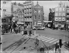 """1950. Rembrandtplein with banner sign: """"Slowdown near zebra crossings"""". #amsterdam #1950 #rembrandtplein"""