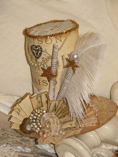 Whimsical vintage paper hat. I know K would love this. One of these days she may event try to make it.