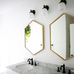 A better shot of those mirrors from #WestElm. They were just the right touch to our bathroom. #reno #renovation #mywestelm #bathroomreno