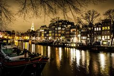 Amsterdam canal by Benoit Chancerel - Amsterdam canal at Night Click on the image to enlarge.