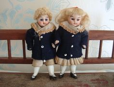Delightful all bisque pair of antique dolls house dolls