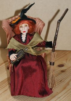 Henrietta Fizzlewyck the Witch has been handsculpted in polymer clay and is one of a kind. She is wired at the arms and legs and may be gently