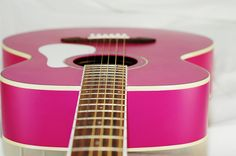 """Undecided between this pink guitar and the other one posted. My daughter is requesting a pink guitar and a harmonica for her 3rd birthday. She's pretty taken with """"The Freewheelin' Bob Dylan""""."""