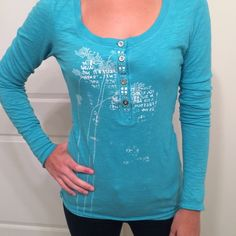 Aqua Free People Top This vibrant Free People top is cozy and chic. It has silver buttons and white details. Looks amazing paired with jeans or even yoga pants. Runs a little long. Great condition. Free People Tops